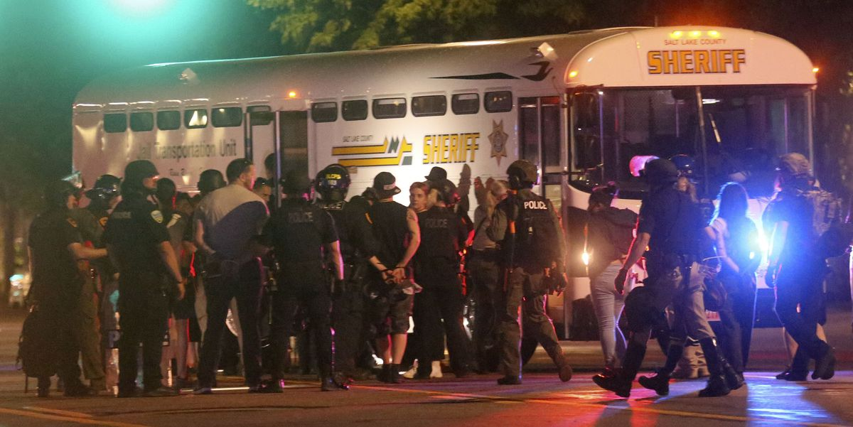 Police take protesters into custody late Saturday after a curfew was put in place in Salt Lake City to quell daylong demonstrations over the death of George Floyd at the hands of Minnesota police last week.