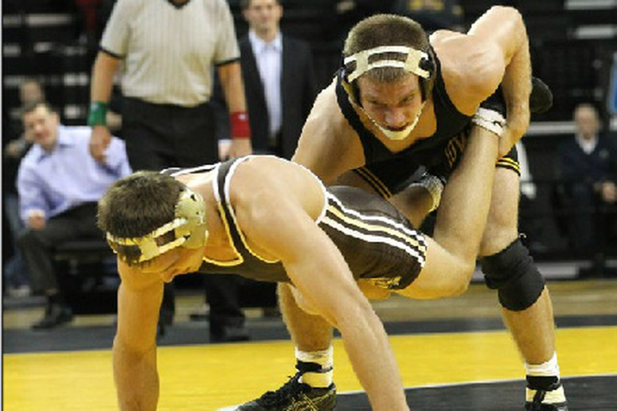 Nick Moore and his opponent decided to eschew the usual wrestling match in favor of a good ol' wheelbarrow race.