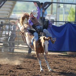 A bareback bronc rider's hat flies off during the Utah High School Rodeo Finals in Heber City on Saturday, June 3, 2017.