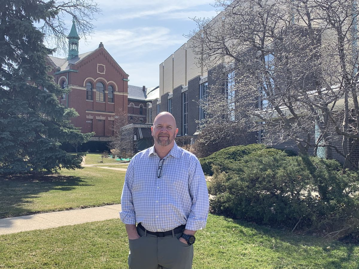 Timothy Nockels, who says he was molested as a boy by the Rev. John Baptist Ormechea when the priest was assigned to Immaculate Conception Parish. The Norwood Park church and the former Passionist monastery are in the background.