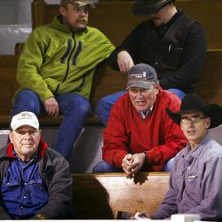 In this Dec. 13, 2012, photo, Idaho State Speaker of the House Scott Bedke, second from right, talks with Phil Munsee, left, a longtime friend of his late father, and Mike Munsee, a cattle dealer at Burley's Livestock Auction, in Oakley, Idaho. Bedke's family heritage is established as being some of the founding settlers in the Oakley area, a legacy that three generations later is not lost on Scott. Along with his brother Eric, Scott runs one of the largest operations of cow-calf pairs on 130,000 acres of federal grazing allotments in Idaho and Nevada, and he recently defeated three-term speaker Lawerence Denney in the 57-member Republican caucus. (AP Photo/The Idaho Statesman, Darin Oswald)  MANDATORY CREDIT; LOCAL TV OUT (KTVB 7)