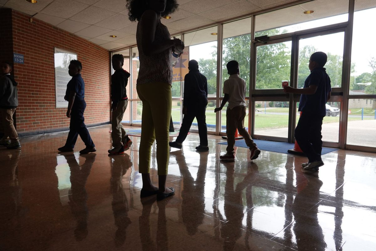 Students walk in a hallway between classes at Gardenview Elementary School in Memphis.