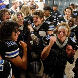 Stansbury players celebrate after winning a high school football game against Tooeleat Stansbury High School in Stansbury Park on Friday, Sept. 17, 2021.
