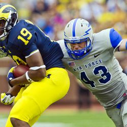Michigan tight end Devin Funchess (19) makes a reception while defended by Air Force linebacker Jared Jones (43) in the third quarter of an NCAA college football game, Saturday, Sept. 8, 2012, in Ann Arbor, Mich. Michigan won 31-25.