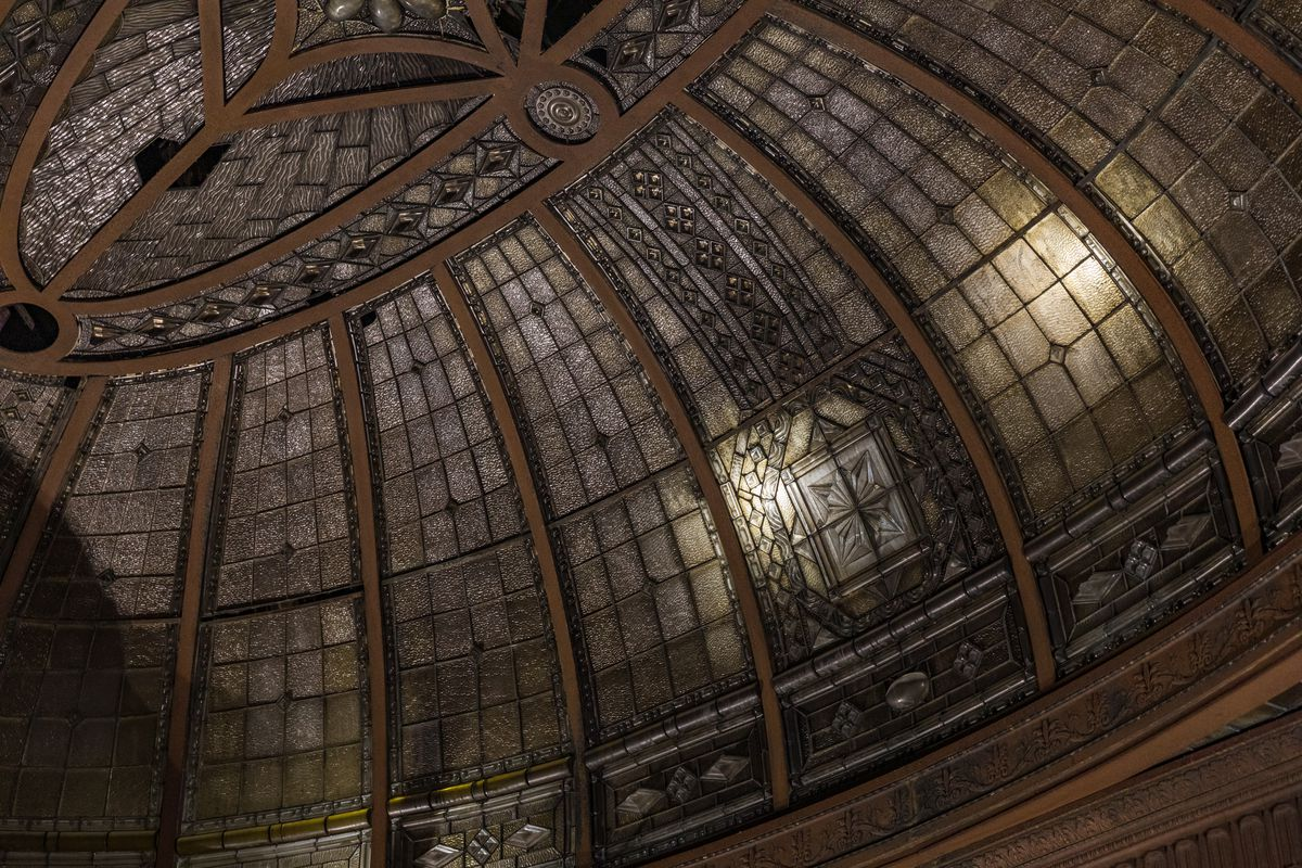 A large skylight made of leaded glass windows with steel supporting beams. The skylight is dome shaped.