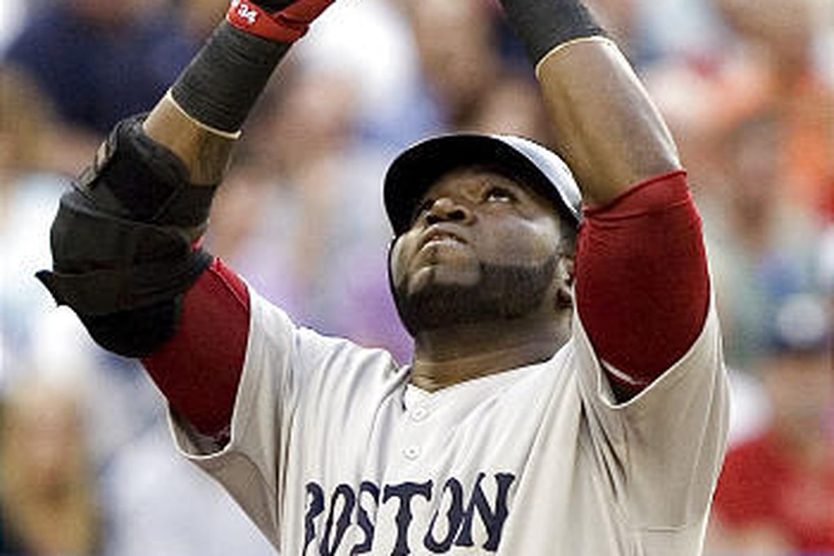 David Ortiz celebrates as he crosses home plate following his second-inning solo home run.