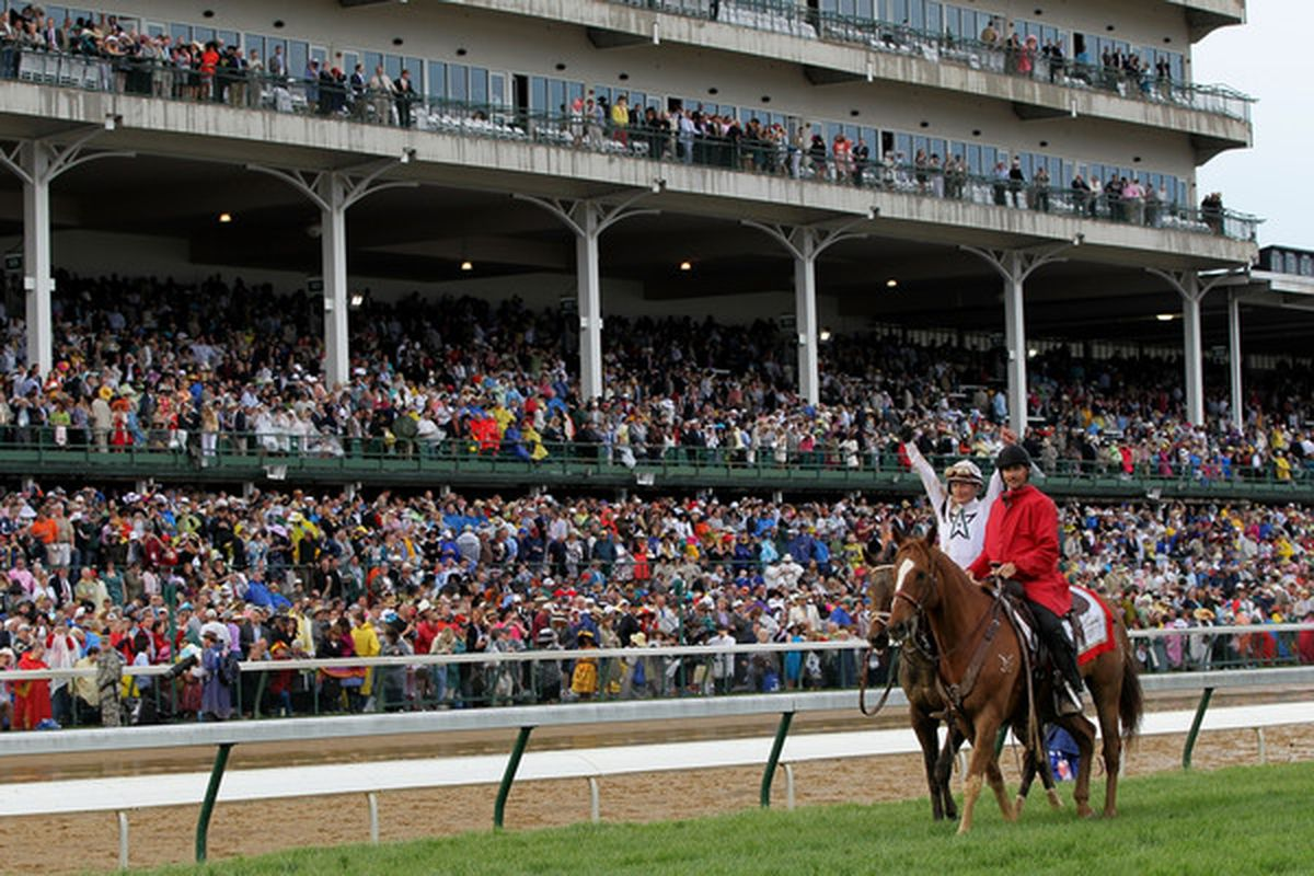 LOUISVILLE, KY - MAY 01:  Calvin Borel celebrates atop Super Saver after winning the 136th running of the Kentucky Derby on May 1, 2010 in Louisville, Kentucky.  (Photo by Jamie Squire/Getty Images)