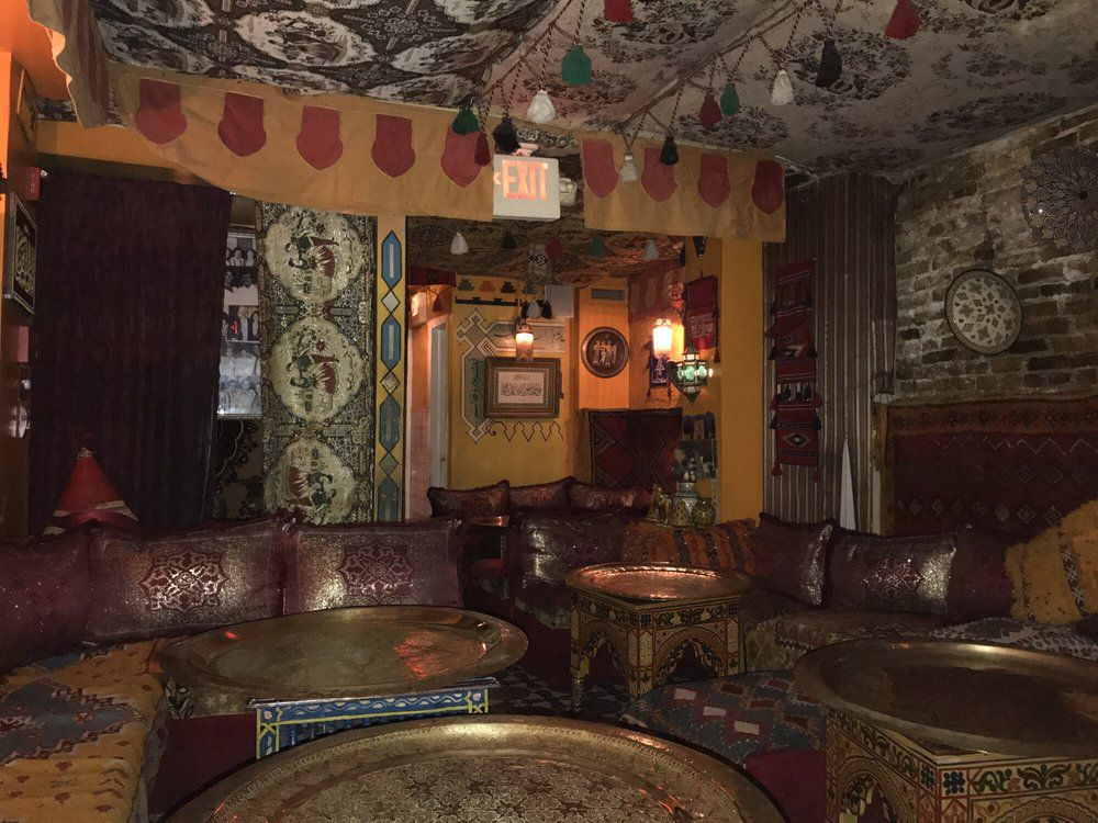 a dimly lit restaurant with a moroccan theme