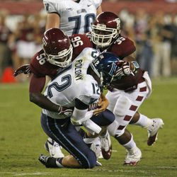 Villanova's Chris Polony (12) is sacked by Temple's Olaniyi Adewole (56) and Nate D. Smith (35) during the first half of an NCAA college football game on Friday, Aug. 31, 2012, in Philadelphia.