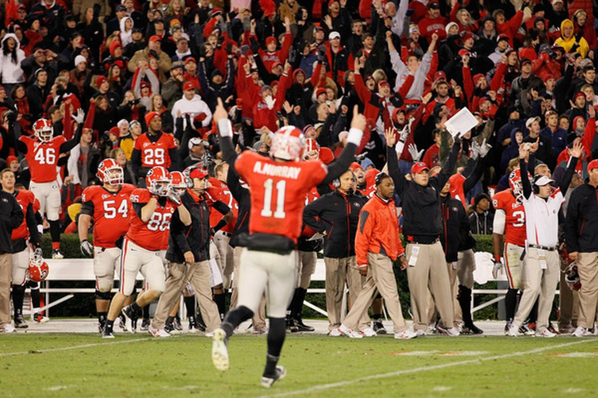 Georgia players, coaches, and fans celebrate after the 2011 football schedule was announced.