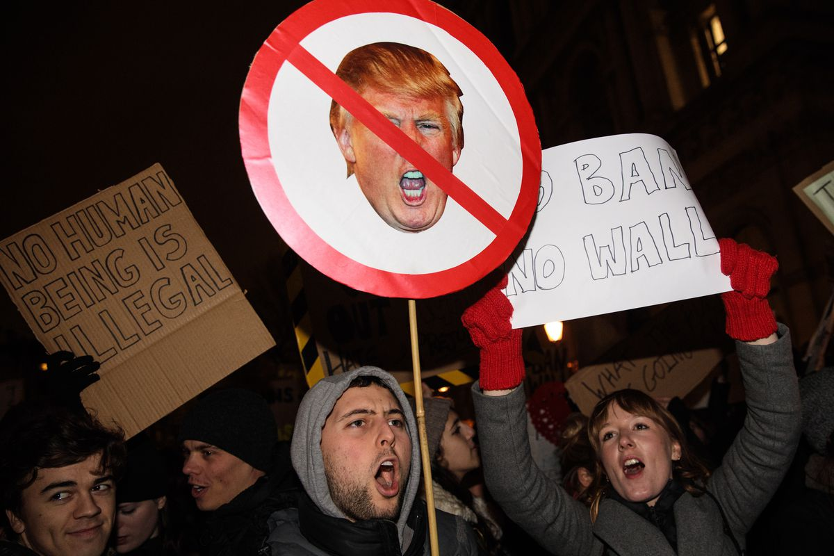 Demonstrators holding placards chant during a protest outside Downing Street against U.S. President Donald Trump's ban on travel from seven Muslim countries on January 30, 2017 in London, England.