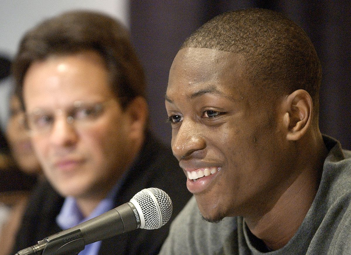 Marquette coach Tom Crean looks on Dwyane Wade announces his availability for the NBA draft in 2003.