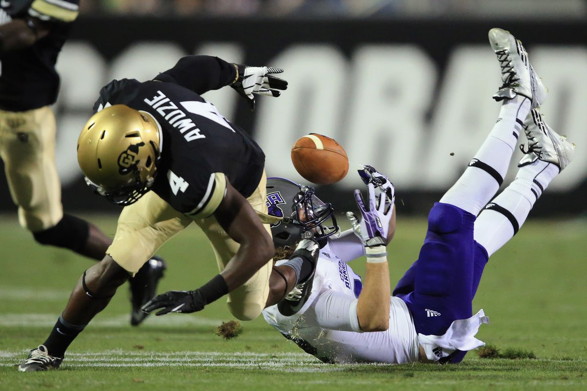 BOULDER, CO - Colorado Buffaloes cornerback Chidobe Awuzie (4) lowers the boom against Central Arkansas Bears wide receiver Justin Burdette (82) to break up a pass target.