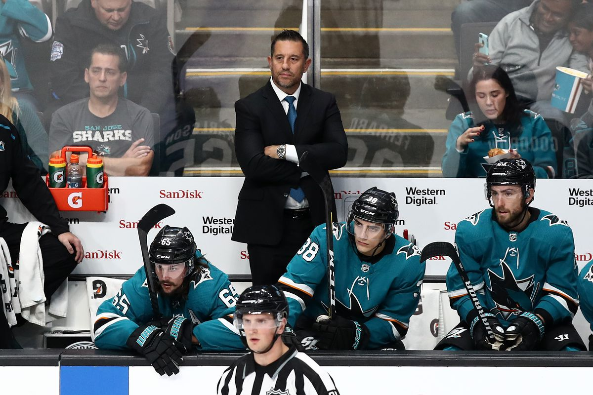 San Jose Sharks assistant coach Bob Boughner watches the Sharks play against the Vegas Golden Knights at SAP Center on October 04, 2019 in San Jose, California.