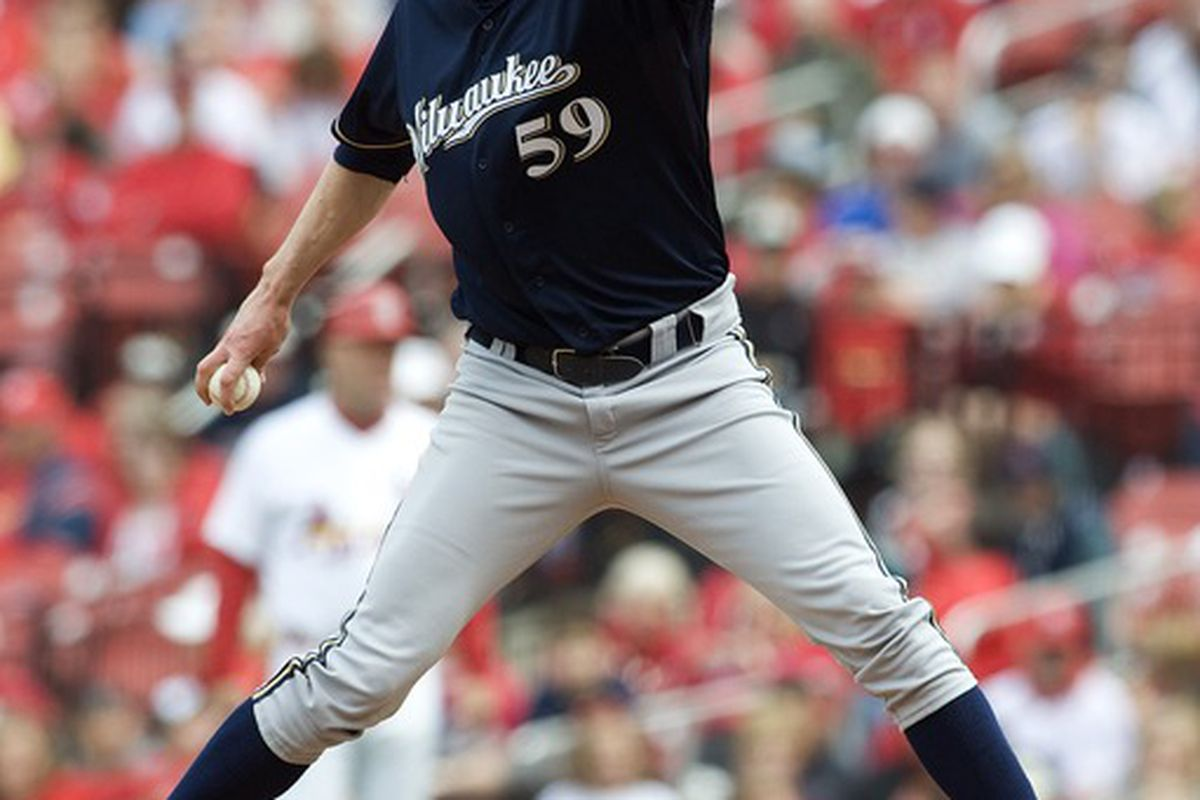 April 29, 2012; St. Louis, MO. USA; Milwaukee Brewers relief pitcher John Axford (59) throws to a St. Louis Cardinals batter in the ninth inning at Busch Stadium. Milwaukee defeated St. Louis 3-2. Mandatory Credit: Jeff Curry-US PRESSWIRE