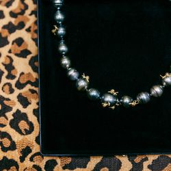 <b>Vibes</b> pearl necklace with gold snail detail, $9,030.