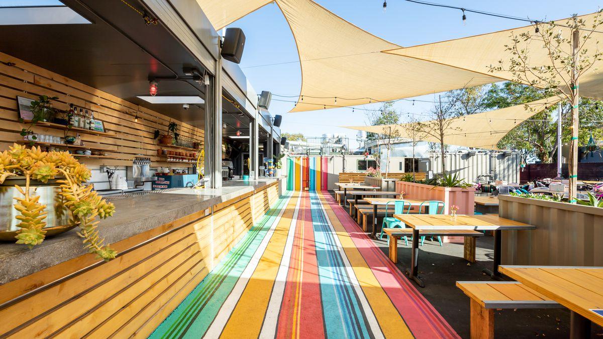 A colorful walking path and the bar area at Nido's Backyard