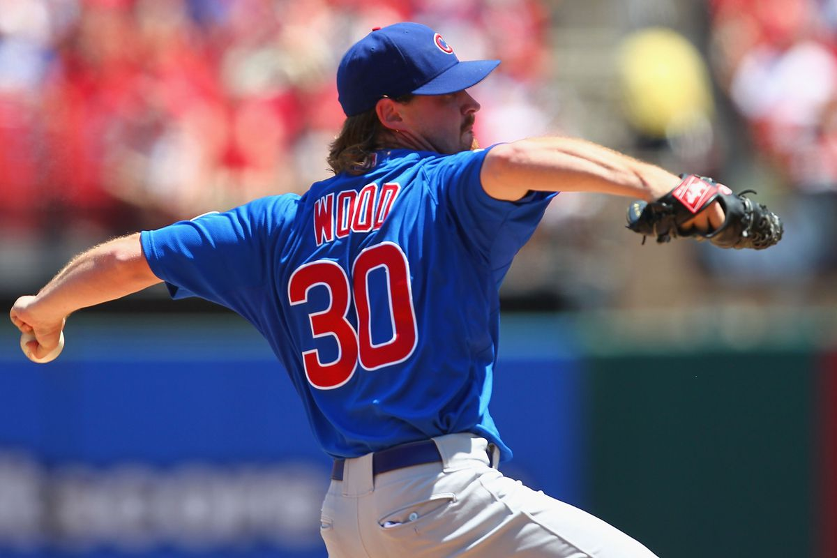 Starter Travis Wood of the Chicago Cubs pitches against the St. Louis Cardinals at Busch Stadium in St. Louis, Missouri.  (Photo by Dilip Vishwanat/Getty Images)