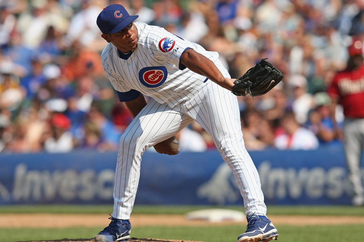 Carlos Marmol of the Chicago Cubs pitches in the 9th inning for a save against the Arizona Diamondbacks at Wrigley Field in Chicago, Illinois. The Cubs defeated the Diamondbacks 3-1. (Photo by Jonathan Daniel/Getty Images)