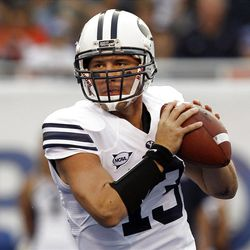 Riley Nelson (13) of the Brigham Young Cougars looks to pass during NCAA football in Boise, Thursday, Sept. 20, 2012.