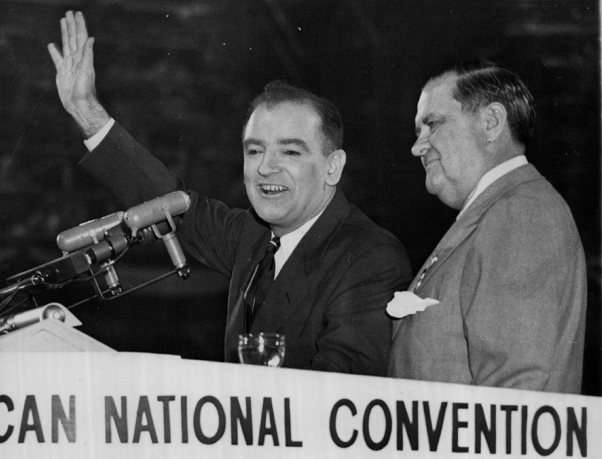 U.S. Sen. Joseph McCarthy (with hand raised) in an undated photo.