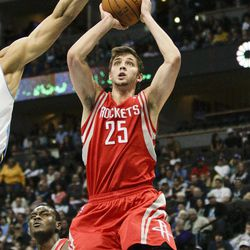 Houston Rockets forward Chandler Parsons (25) shoots against the Denver Nuggets during the first quarter of an NBA basketball game Sunday, April 15, 2012, in Denver.
