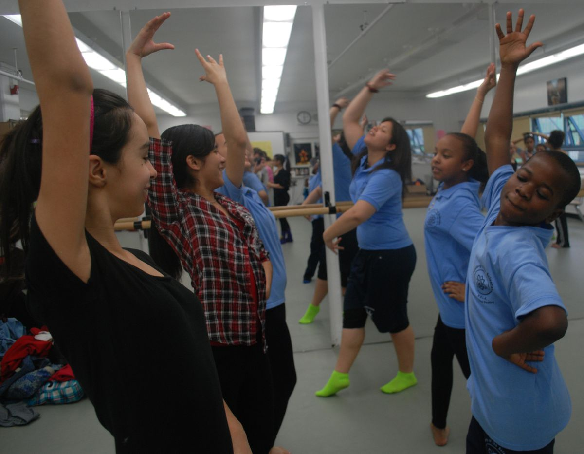 M.S. 244 is broken into a science and arts. Above, a dance troupe rehearses in class.