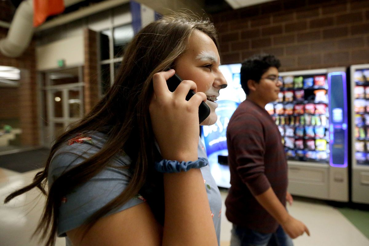 Addy Galbraith borrows her friend Jason Molina's phone to call her father and ask for a ride after theater practice at Orem Junior High School in Orem on Monday, Nov. 6, 2017. Addy is allowed to get a cellphone with a data plan when she turns 14 on Nov. 1