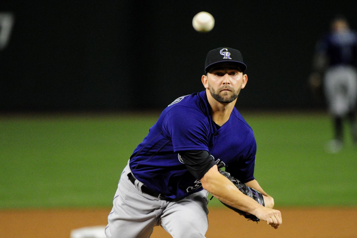 Rockies starter Tyler Chatwood throws a warm-up pitch during his first start of 2016.
