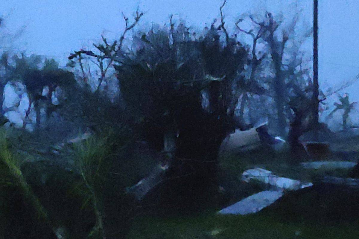 In this photo provided by Glen Hunter, damage from Super Typhoon Yutu is shown outside Hunter's home in Saipan, Commonwealth of the Northern Mariana Islands, Thursday Oct. 25, 2018. As the powerful storm crossed over the island the walls shook in Hunter's
