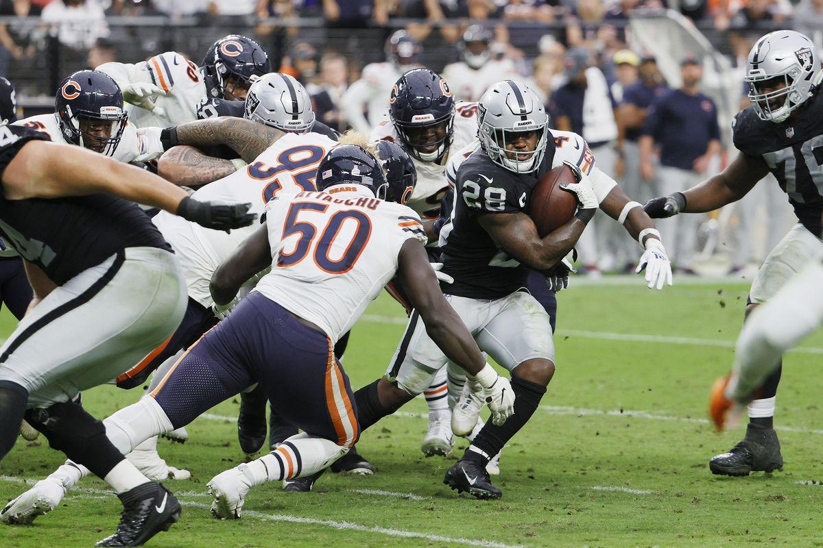 Bears outside linebacker Jeremiah Attaochu tackles Raiders running back Josh Jacobs on Sunday.