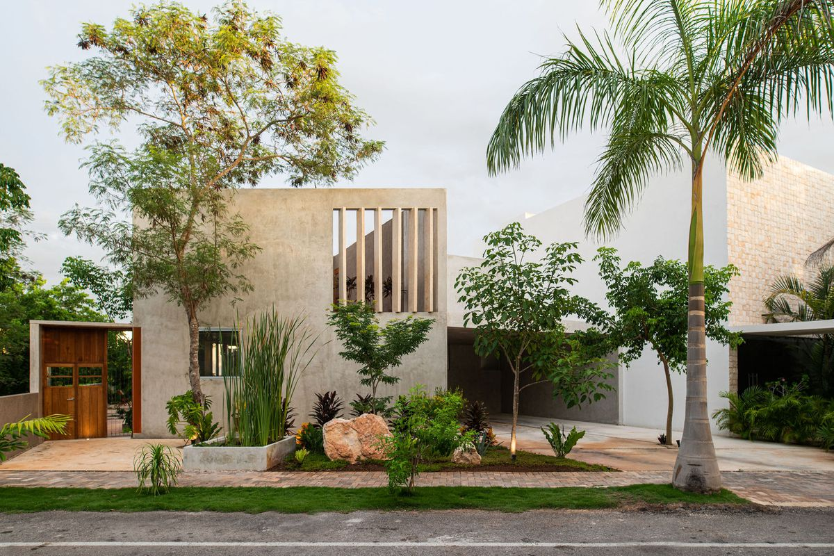 Modern Concrete House Embraces Greenery And A Dash Of Yellow