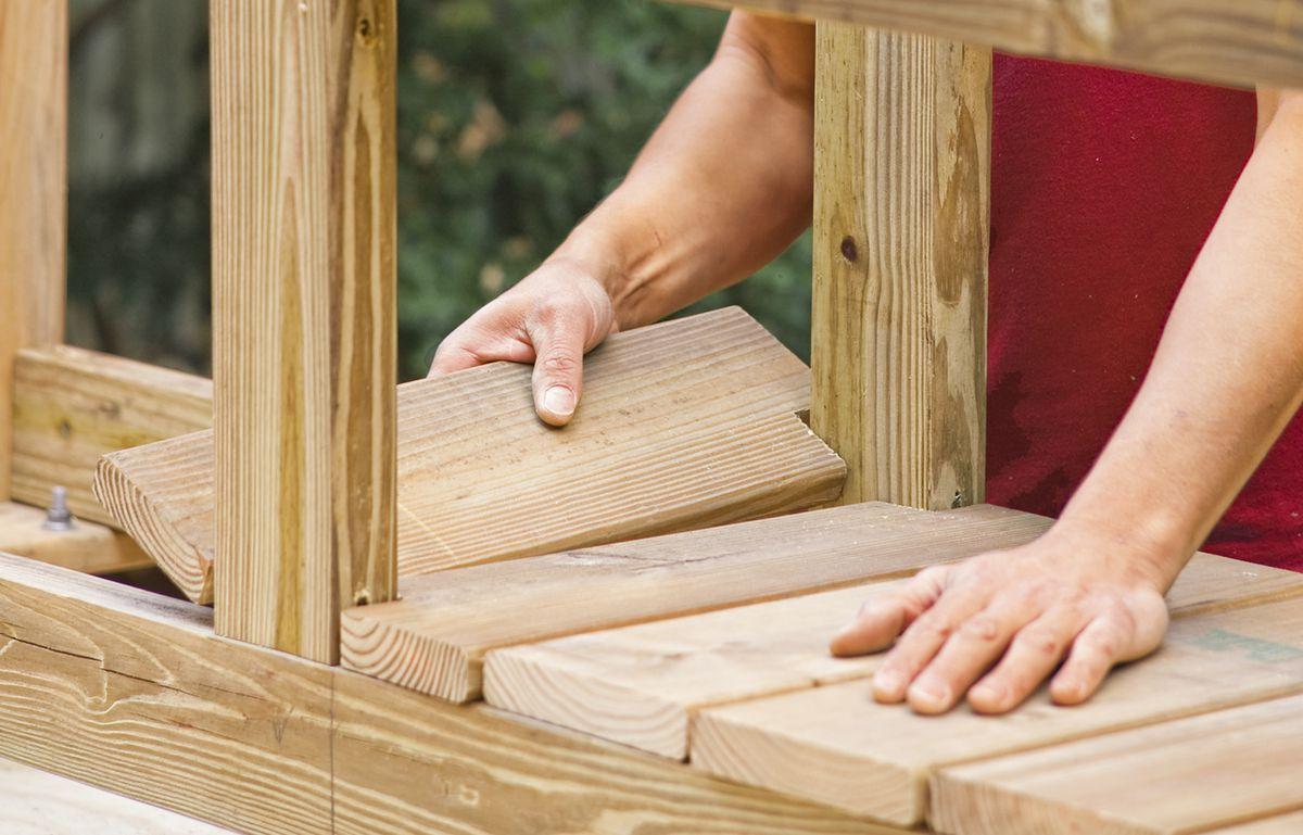 Man Installs Floorboards Of Privacy Planter