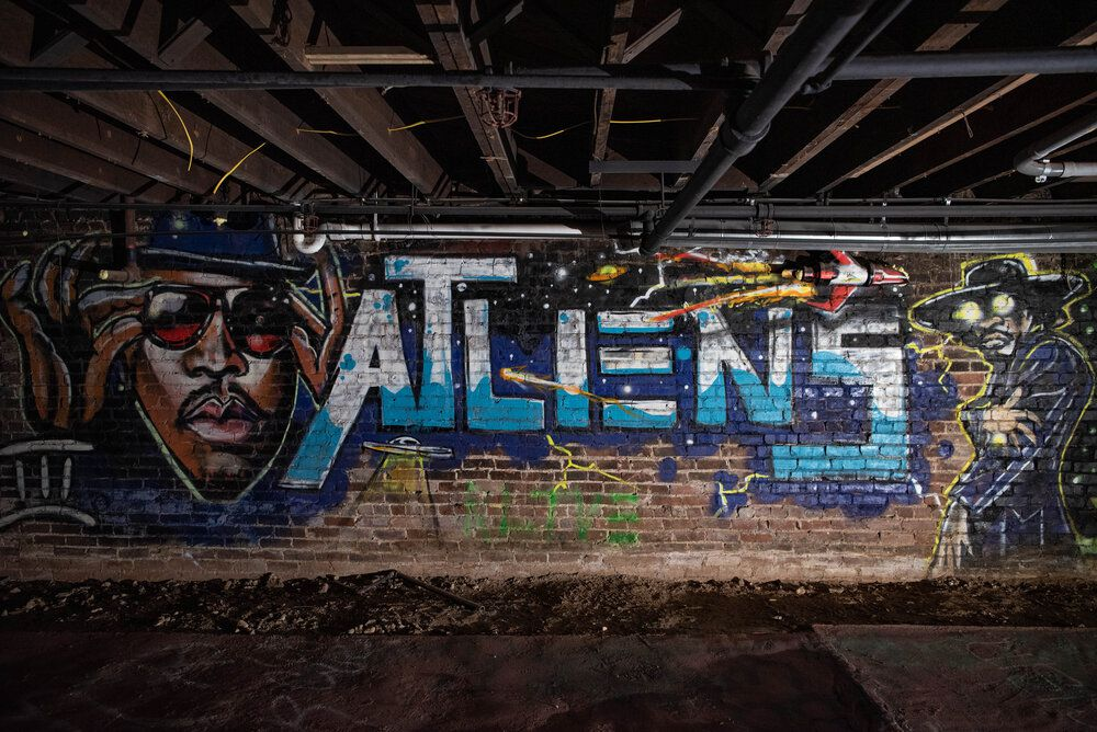 The OutKast mural in the basement at 219 Mitchell Street