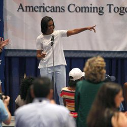 First lady Michelle Obama, accompanied by Vice President Joe Biden's wife Jill Biden, left, speaks to volunteers at a USO service project during the Democratic National Convention in Charlotte, N.C., Thursday, Sept. 6, 2012.