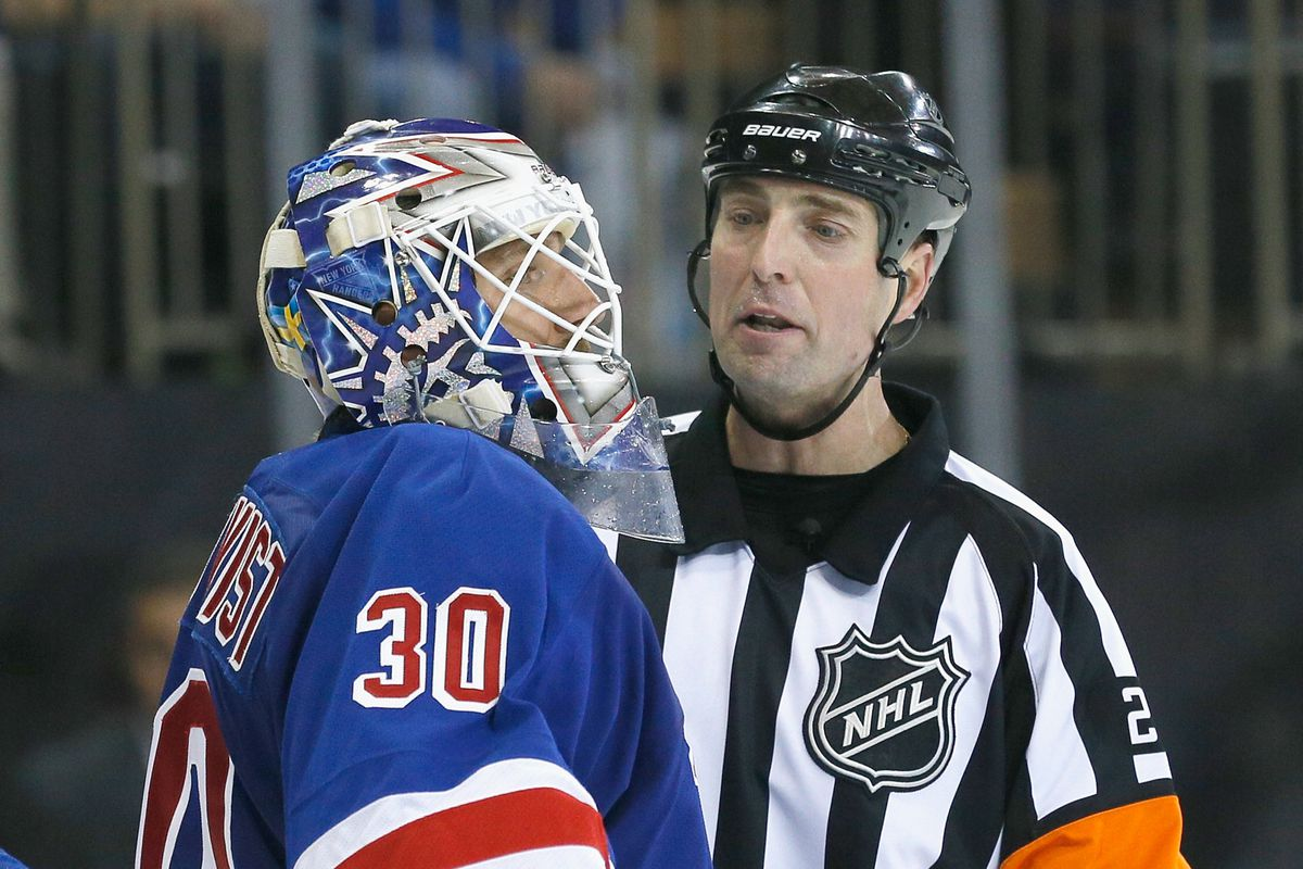 Lundqvist rightfully ignores the referee's long-winded explanation of the coincidental penalty rule.