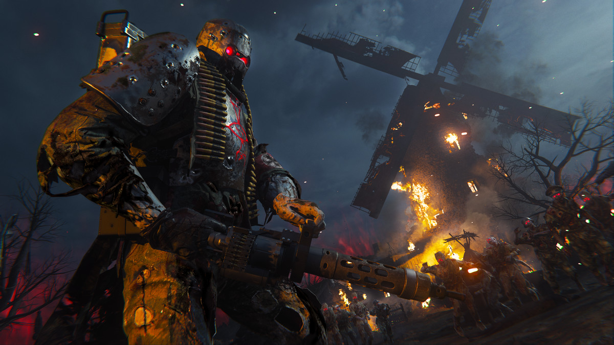 A tank Zombie with a machine gun stands by a burning windmill in Call of Duty: Vanguard