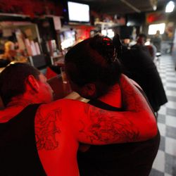 In this photo taken Friday, Sept. 7, 2012, patrons are seen at the King Eddy Saloon, one of the oldest and most colorful dive bars in Los Angeles. The King Eddy Saloon located near the Skid Row will close next September after more than 100 years as a bar.    .
