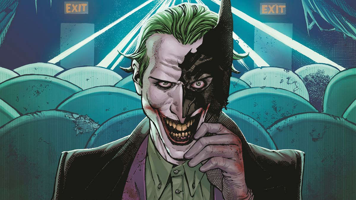 The Joker sits in a movie theater and smiles at the reader through a shattered half of Batman's mask, on the cover of Batman #93, DC Comics (2020).