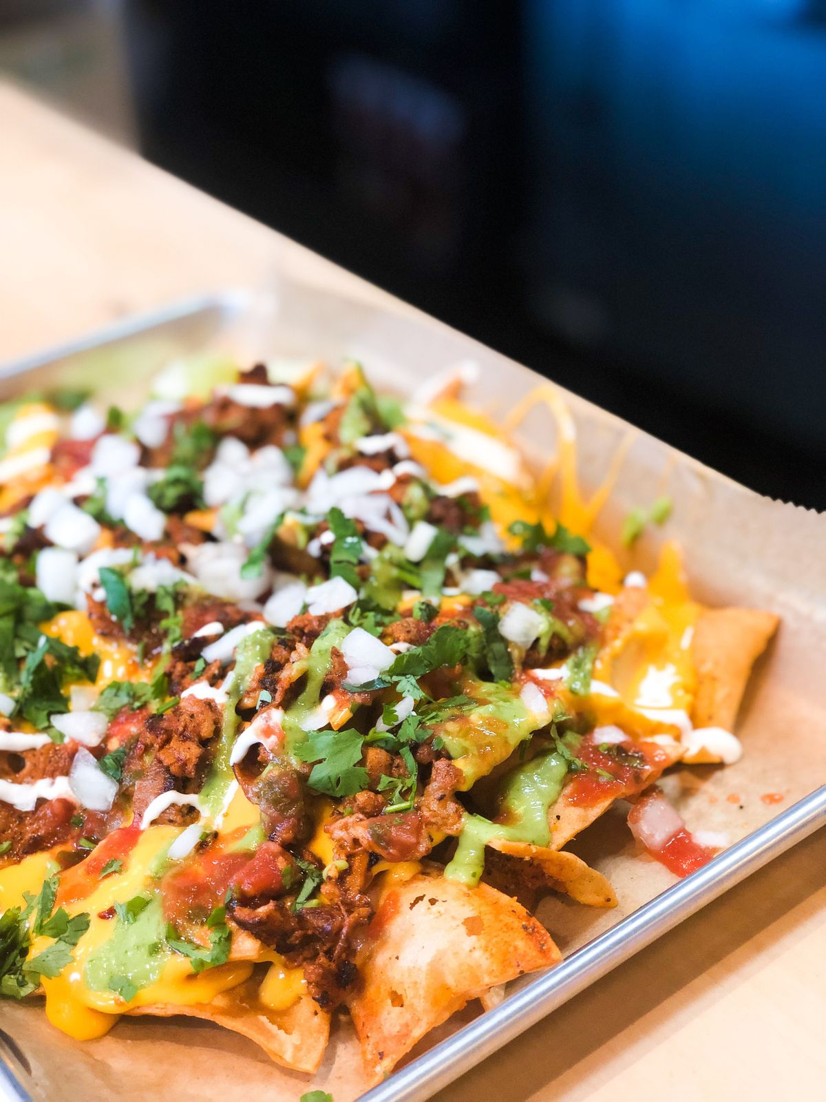 A close-up picture of nachos at Tight Tacos