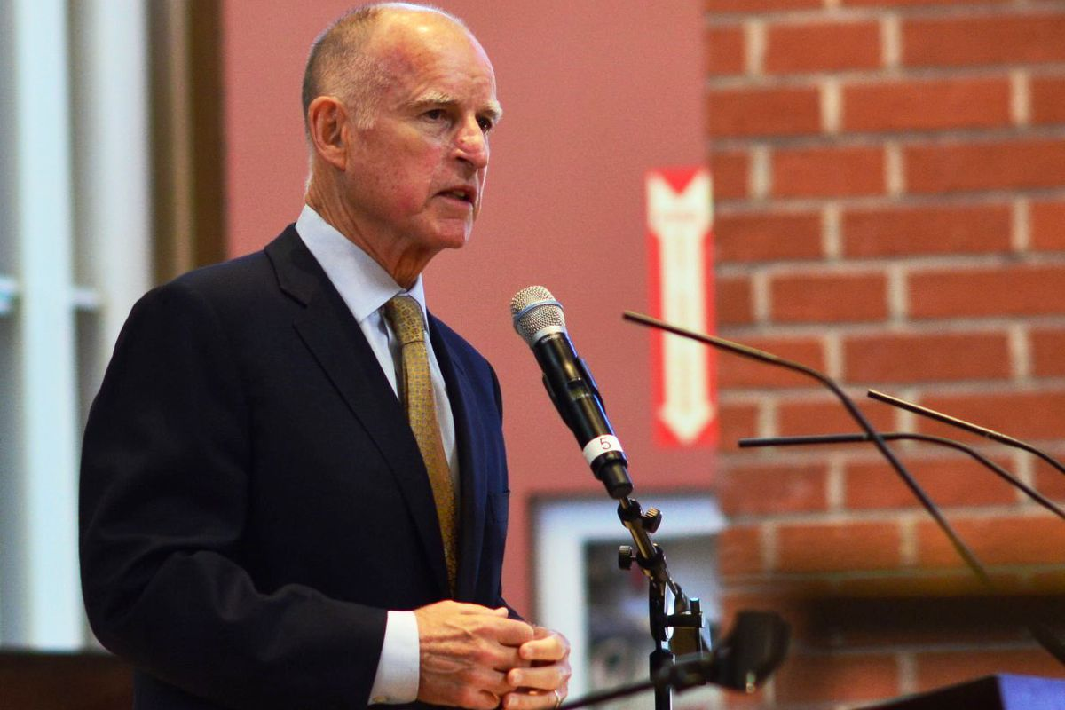 Governor Jerry Brown standing at a podium.