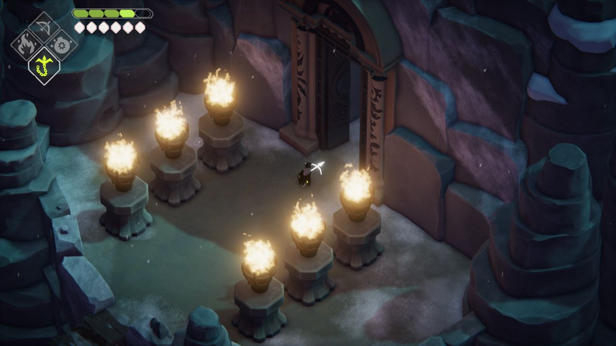 A crow stands under six large fired up torches with an open door nearby