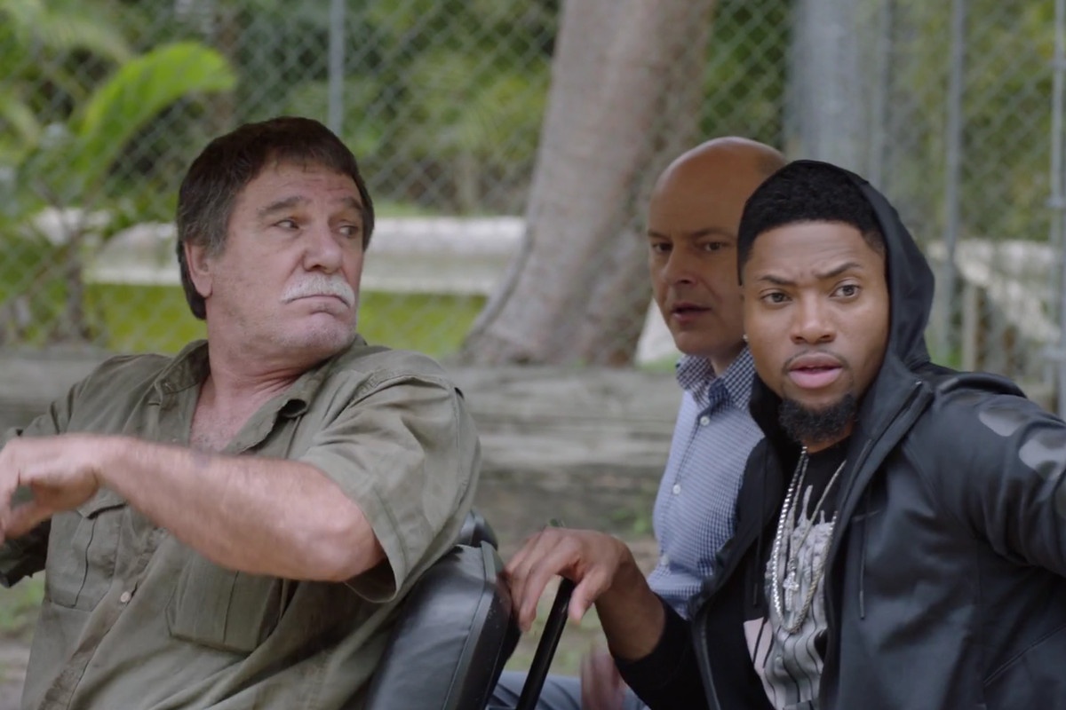 Joe (Rob Corddry) and Reggie (London Brown) search for an exotic gift for Vernon.