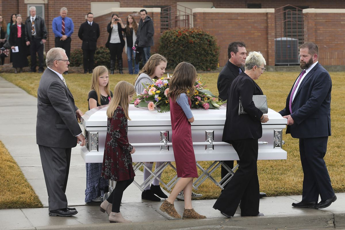 Pallbearers walks with the Milan Haynie's casket during thefuneralfor four members of the Haynie family at the Grantsville Stake Center of The Church of Jesus Christ of Latter-day Saints in Grantsville on Friday, Jan. 24, 2020.