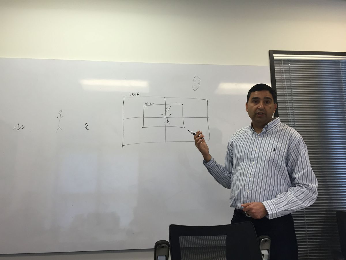 CTO Rajiv Laroia explaining the technology behind Light's camera array, in a conference room at the company's Palo Alto offices