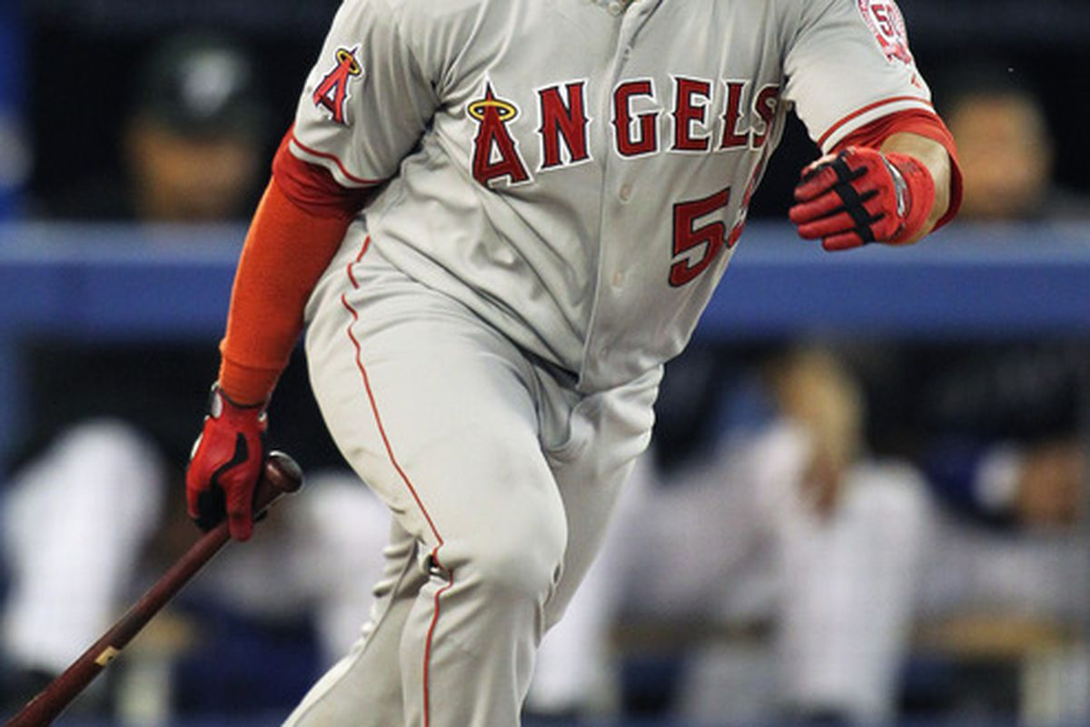 TORONTO,CANADA - SEPTEMBER 19:  Bobby Abreu #53 of the Los Angeles Angels of Anaheim drives a ball against the Toronto Blue Jays in a MLB game on September 19, 2011 at the Rogers Centre in Toronto, Canada. (Photo by Claus Andersen/Getty Images)