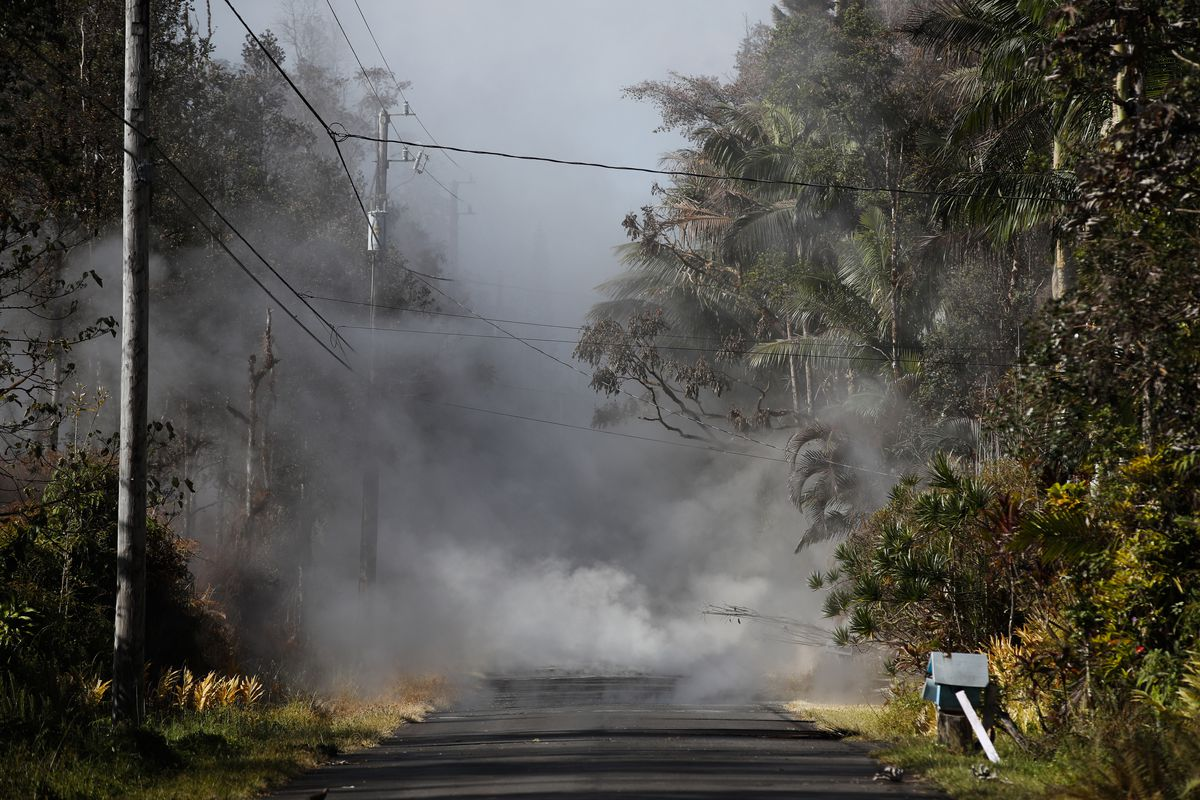 Toxic gases rise from cracks in the Leilani Estates subdivision near Pahoa, Hawaii, on Friday. Lava from the Kilauea volcano has destroyed at least 36 structures, including 26 homes.   Jae C. Hong/Associated Press