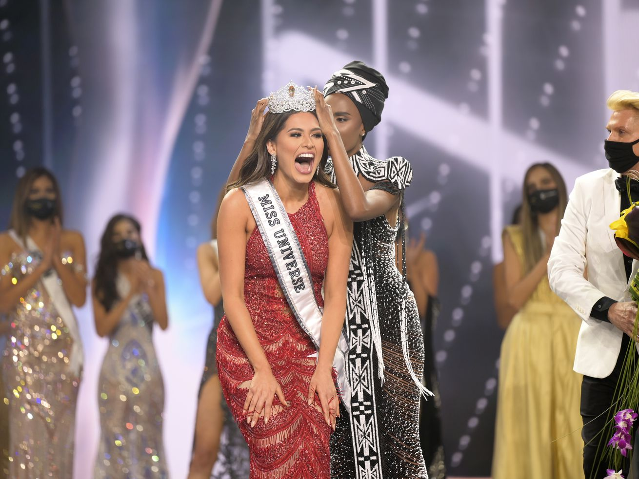 Miss Universe Mexico 2020 Andrea Meza reacts as she is crowned by Miss Universe 2019 Zozibini Tunzi at the 69th Miss Universe Competition.