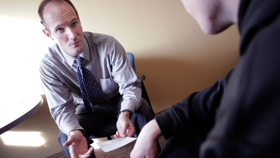 Dr. Christian Thurstone, right, counsels a patient in Denver Health's STEP substance abuse program on Feb. 1.