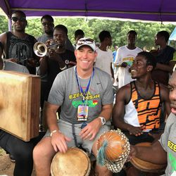 Ziggy Ansah (left) and Chad Lewis (center) play music during the Ziggy Ansah Football Camp in Ghana.